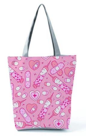 schoudertas met ritssluiting; roze medische symbolen